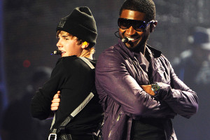 Justin performing with pop icon Usher.