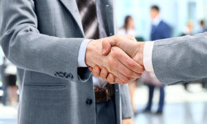 Two men shaking hands in business